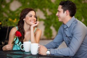 A couple is drinking coffee
